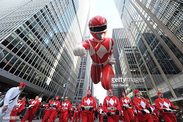 As one of the largest balloons the Red Mighty Morphin Power Ranger soars through the streets of New York City at the 89th annual Macys Thanksgiving...