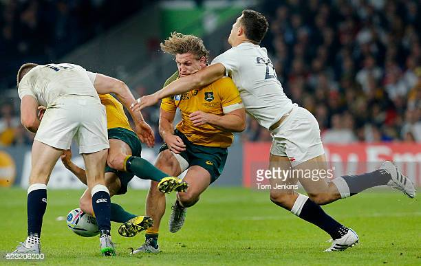 As Owen Farrell shoulder charges Matt Giteau Sam Burgess tackles Michael Hooper round the neck during the England v Australia Rugby World Cup Pool A...