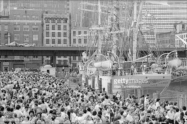 As part America's Bicentennial Celebration, a crowd of people line the South Street Seaport as they look at the Norwegian naval training ship,...