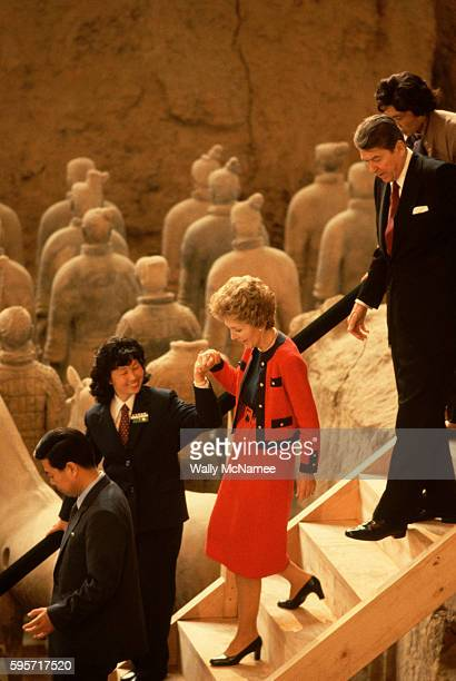 As part of a day of sightseeing on their 1984 state visit to the People's Republic of China President Ronald Reagan and his wife Nancy walk down the...