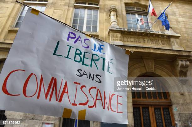 As part of a global movement March for Science protesters march past the high school Lycée Fenelon to demonstrate on April 22, 2017 in Paris to...