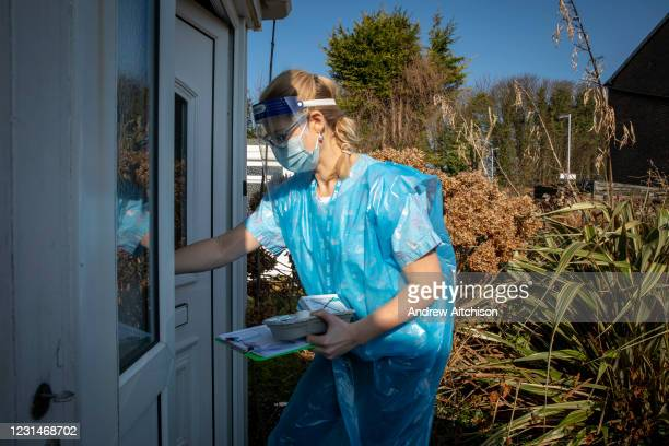 As part of a home visiting service for housebound patients Dr Fordham of the Channel Health Alliance dressed in the appropriate PPE attends a patient...