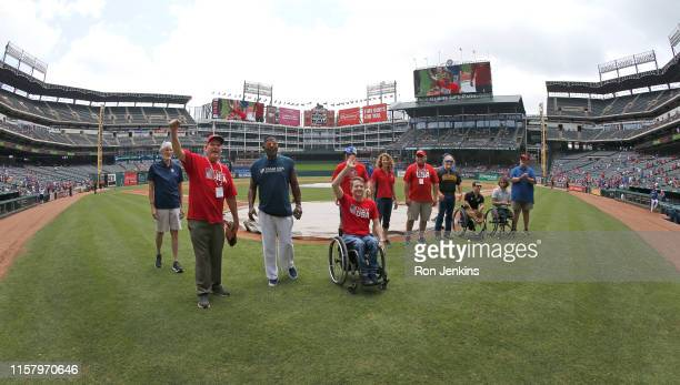 As part of Olympics Day Olympians and Paralympians are introduced before the Chicago White Sox play the Texas Rangers at Globe Life Park in Arlington...