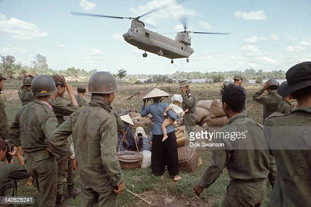 As part of Operation Cedar Falls a US Army Chinook helicopter arrives to evacuate civilians from the Iron Triangle village of Ben Suc Vietnam January...