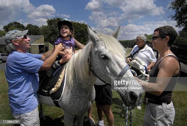 As part of the Mitey Riders program Lexi gets to enjoy horseback riding at Misty Meadows farm in Weddington North Carolina July 22 2009 Lexi has a...