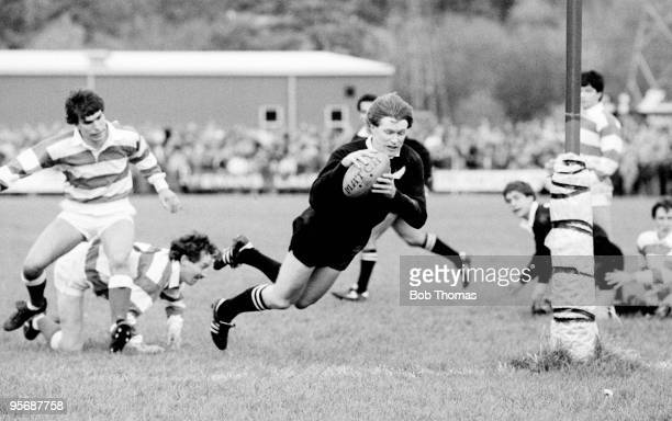 As part of the New Zealand All Black's Rugby Union Tour of Great Britain New Zealand captain Stu Wilson dives over to score his second try after...