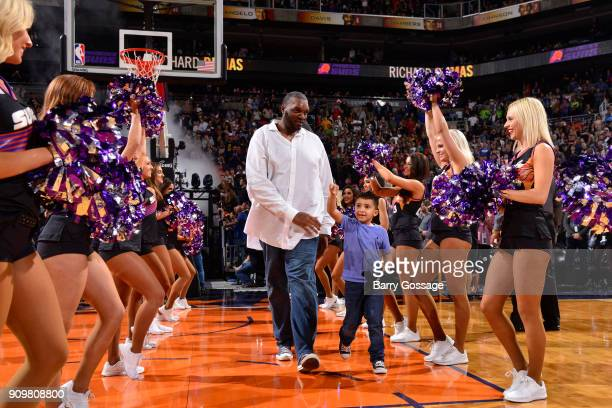 As part of their 50th season celebration the Phoenix Suns honor former player Oliver Miller before the game against the Houston Rockets on January 12...