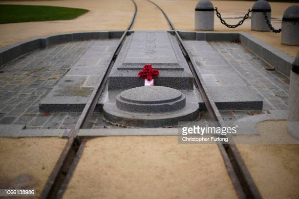 As people gather to pay their respects a poppy wreath lies on the spot in the clearing of Rethondes where the armistice between the Allies and...