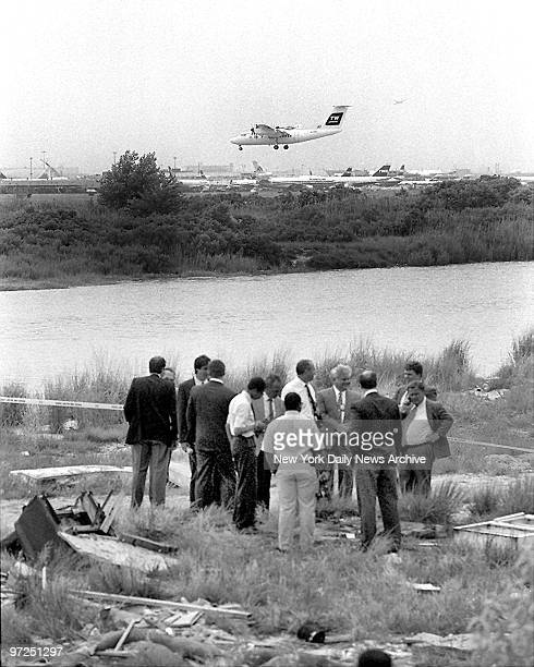 As plane lands in background police surround body dumped in remote area of JFK Body remains of the serial killer Joel Rifkin