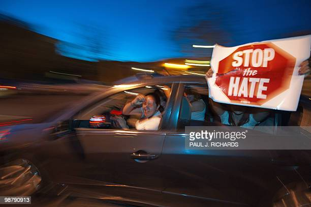 As protestors line the streets around the Arizona State Capitol other supporters cruise in their cars with signs and rally against the Arizona State...