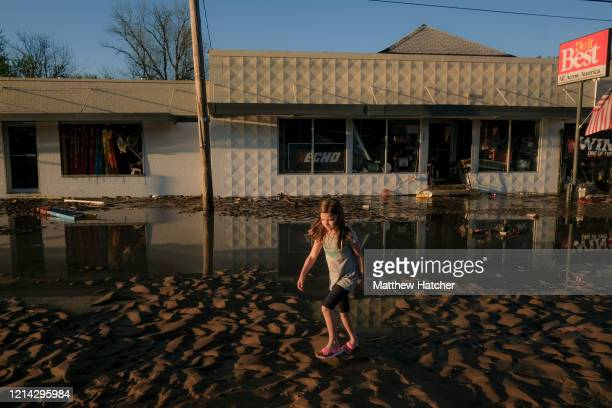 As record floodwaters begin to recede, local residents walk the ruined streets to see the extent of damage following extreme flooding throughout...