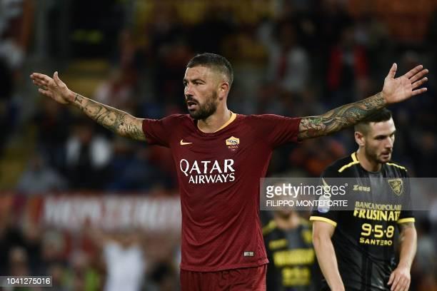 As Roma's defender Aleksandar Kolarov from Serbia celebrates after scoring a goal during the Serie A football match Roma vs Frosinone on September 26...