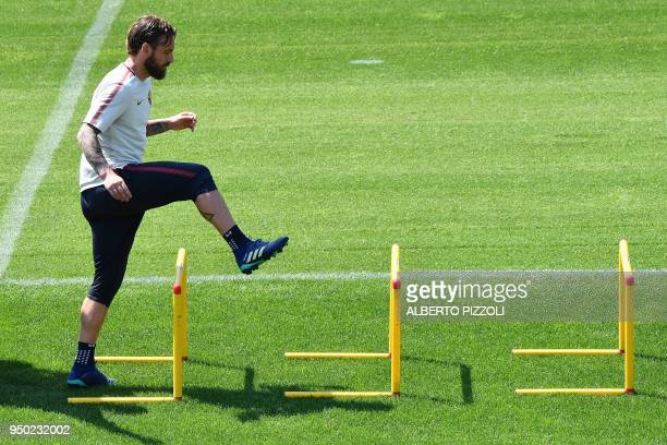 As Roma's midfielder and captain Daniele De Rossi takes part in a training session on April 23 2018 at Trigoria training ground in the outskirts of...