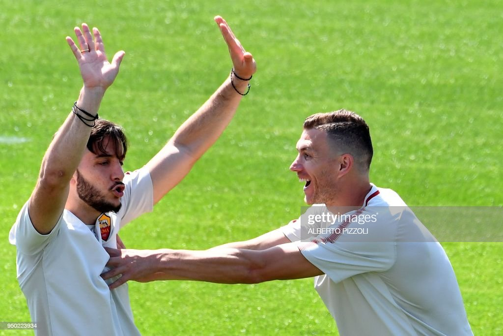 As Roma's players defender Kostas Manolas (L) and striker Edin Dzeko joke as they take part in a training session, on the eve of the Champions League semi-final, first-leg football match Liverpool vs AS Roma on April 23, 2018 at Trigoria training ground in the outskirts of Rome.