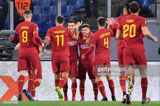 As Roma's Spanish forward Carles Peres celebrates after scoring a goal during the UEFA Europa League round of 32 first leg football match between AS...