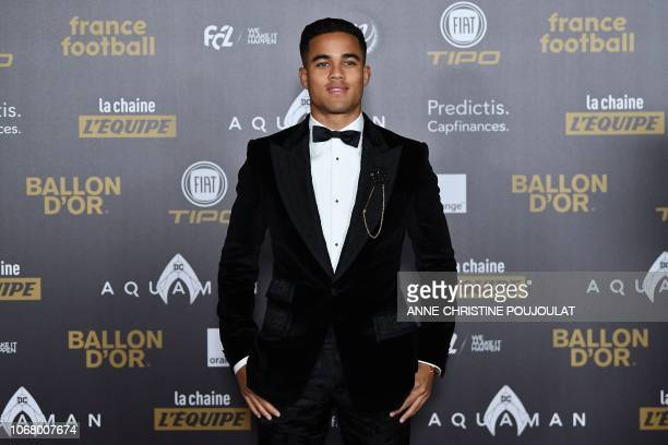 As Rome's Dutch midfielder Justin Kluivert, son of Patrick Kluivert poses upon arrival at the 2018 Ballon d'Or award ceremony at the Grand Palais in...