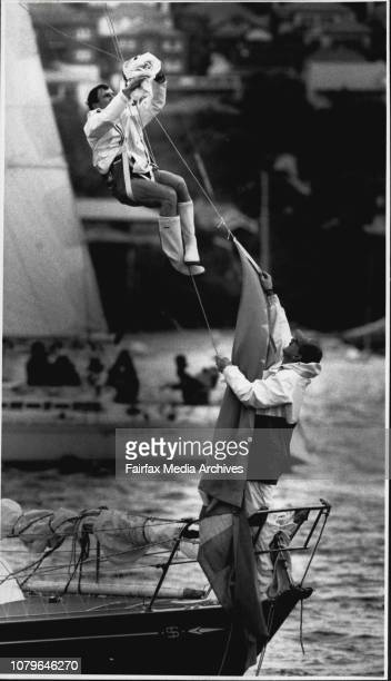 """As Sailing Boats Star Ocean Race Through Heads.The start of the Mooloolaraba yacht race.Crewman on """"Sciolto"""" trees a snag in rigging. April 3, 1990. ."""