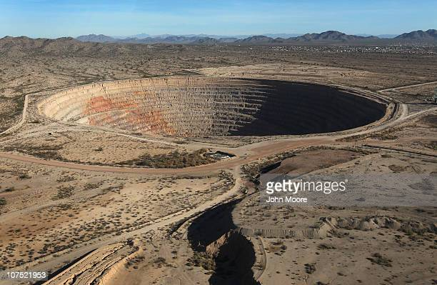 As seen from the air a copper mine leaves a gaping hole in the Sonoran Desert on December 9 2010 near Casa Grande Arizona Drug smugglers and illegal...