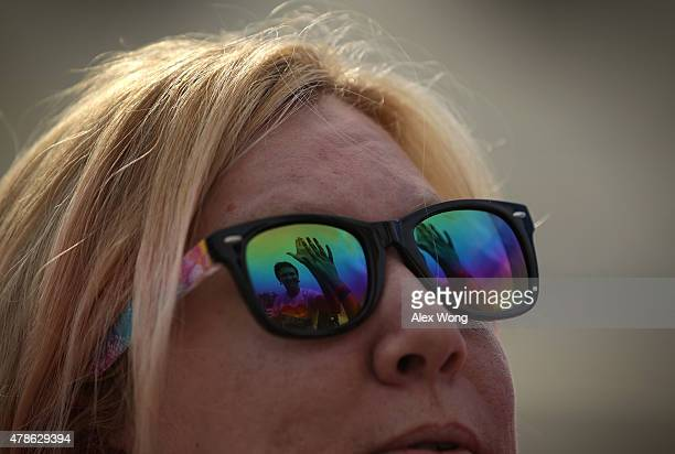 As seen on reflection on her glasses Katherine Nicole Struck of Frederick Maryland hifives another samesex marriage supporter outside the US Supreme...