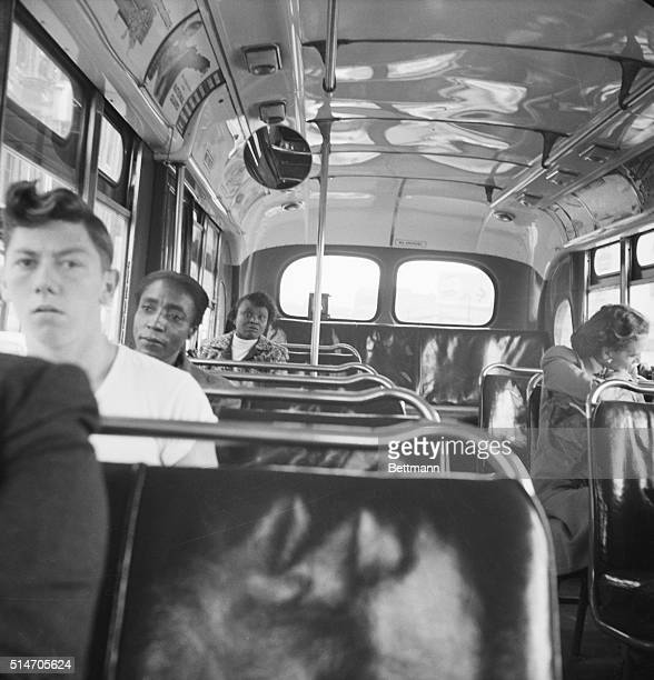 Despite a court ruling on desegregating buses white and blacks continue to be divided by their own choice