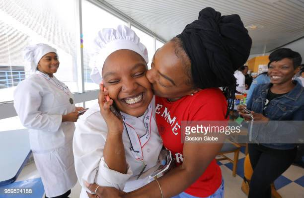 As she talks to her father on the phone 18yearold Taya Henderson is kissed by her mother Ebony Henderson after her team won the Cooking Up Change...