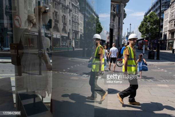 As some non-essential shops re-open, shoppers return to Oxford Street while social distancing measures are put in place by the various retail shops...