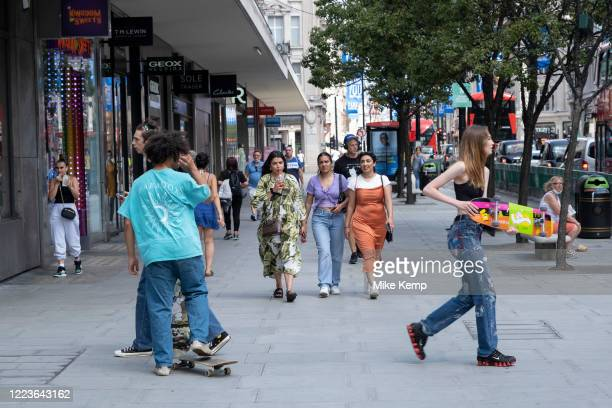 As some nonessential shops reopen shoppers return to Oxford Street while social distancing measures are put in place by the various retail shops...