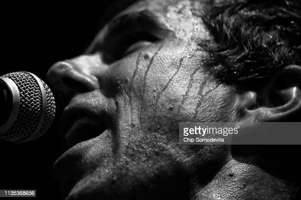 As sweat pours down his face US Senate candidate Rep Beto O'Rourke addresses a campaign rally at the House of Blues on November 05 2018 in Houston...