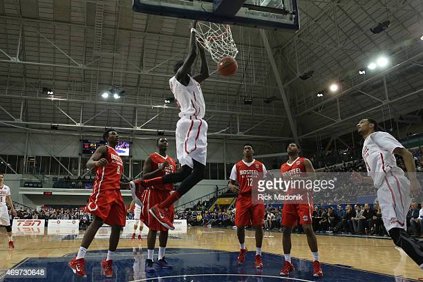 TORONTO APRIL 14 As Team Red stands around they watch Thon Maker slam the ball home The Biosteel All Canadian basketball game 2nd half action...