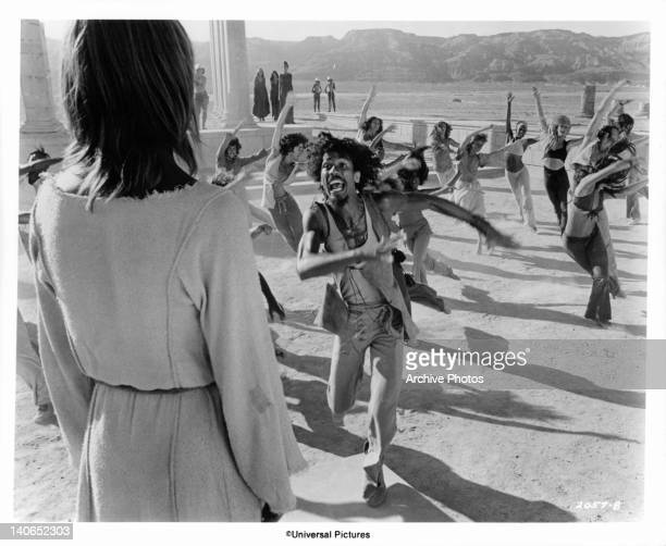 As Ted Neeley looks on, Lawrence Marshall leads the Apostles and their women in a dance expressing support and devotion in a scene from the film...