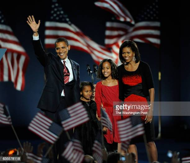 As the 44th President of the United States of America Barack Obama takes the stage with his daughters Sasha and Malia and wife Michelle at his side...