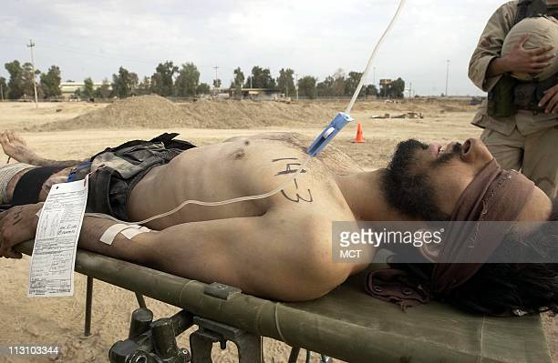 As the battle in Fallujah subsides and insurgents begin turning themselves in military medics are faced with treating those who only days before may...