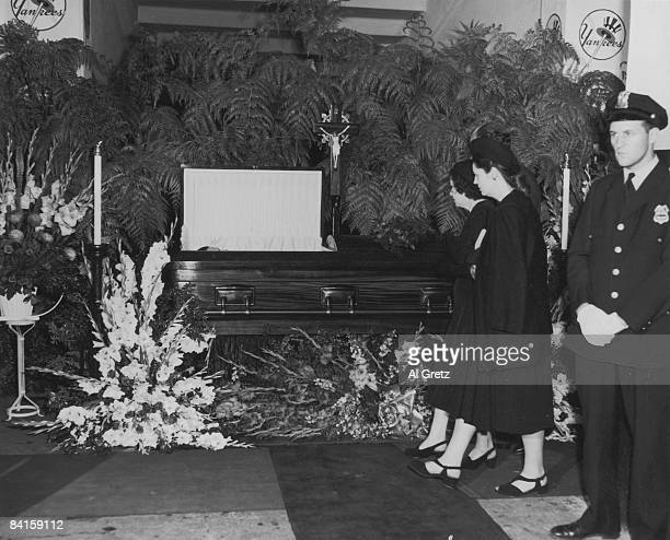 As the body of American baseball player Babe Ruth lies in state in the rotunda of Yankee Stadium his wife Claire Ruth and daughter Julia Ruth...