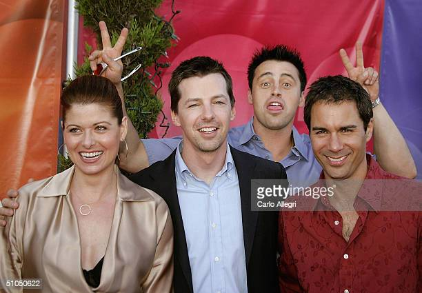 As the cast of 'Will and Grace' Debra Messing Sean Hayes and Eric McCormack pose for photos they are upstaged by actor Matt LeBlanc from the new show...