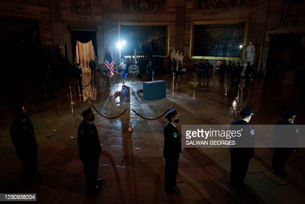 As the ceremony begins, US Capitol Police Officers stand in the Capitol Rotunda where fellow officer Brian Sicknick will lie in honor in the US...