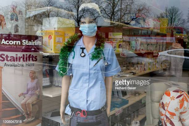 As the Coronovirus pandemic takes hold across the UK with 53 cases now reported by health authorities the window of a medical equipment business in...