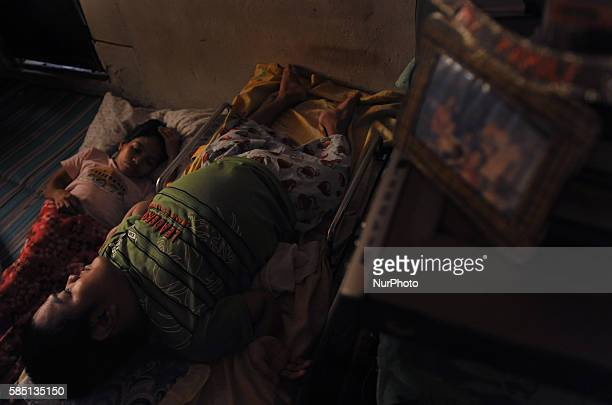 As the day ends Marites rearranges the living room to a sleeping area and prepares Denis to bed The two siblings lull themselves to sleep thanking...