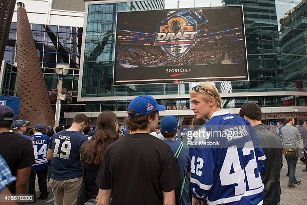TORONTO JUNE 26 2015 As the draft gets underway the fans start to get anxious about the Leaf's choices Toronto Maple Leaf fans congregate at Maple...