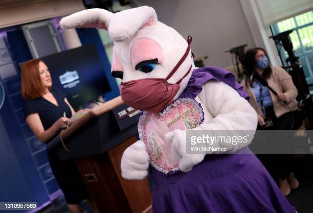 As the Easter Bunny makes a brief appearance, White House Press Secretary Jen Psaki speaks during a daily press briefing at the James Brady Press...