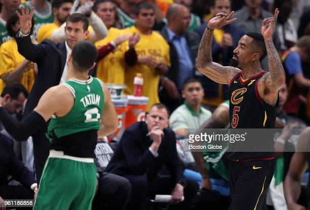 As the final horn sounds in the game Cleveland Cavaliers' JR Smith celebrates their win at right while the Celtics' Jayson Tatum untucks his jersey...