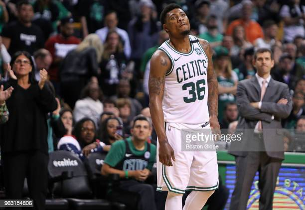 As the final seconds tick off the clock Boston Celtics Marcus Smart and head coach Brad Stevens react as the fans applauded the home team for one...