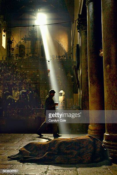LIGHT – As the first light entered a window above the altar of the 4th century church each morning Palestinians sought the rituals of normal life...