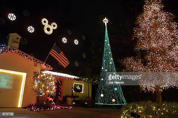 As the holiday season approaches, homeowners get into the Christmas spirit by decorating their homes December 4, 2001 with lights and ornaments in...
