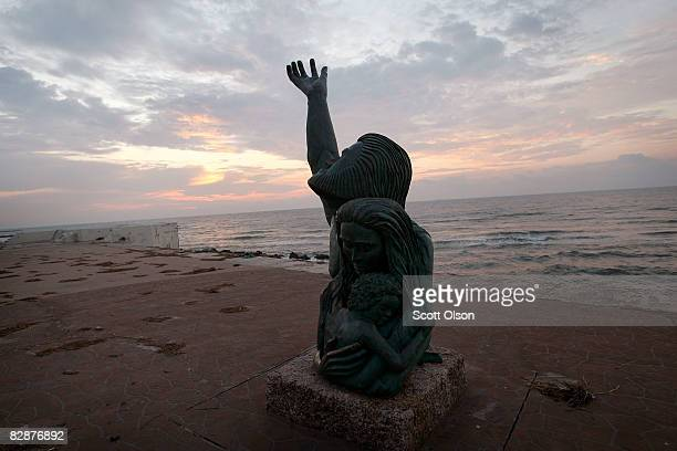 As the island continues to recover from Hurricane Ike the sun rises behind the 1900 Storm Memorial September 18 2008 in Galveston Texas The sculpture...