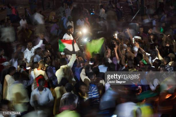 """As the lead protester reads each point the crowd around him shouts """"revolution"""" at the sit-in on May 06, 2019 in Khartoum, Sudan. Tuesday is the..."""