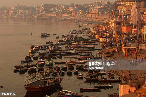 As the life starts its day and more and more people fill the empty Ghats along the River Ganges at Varanasi, the silence is replaced by a market like...