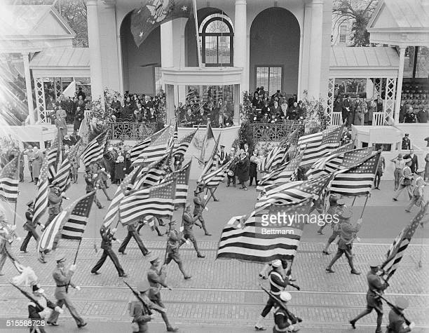 As the newly inaugurated president of the United States, Franklin D. Roosevelt officiates at his first function by reviewing the inaugural parade...