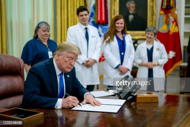 As the novel coronavirus pandemic continues in the United States President Donald Trump signs a proclamation honoring National Nurses Day in the Oval...