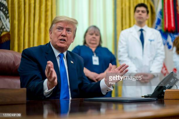 As the novel coronavirus pandemic continues in the United States President Donald Trump talks to journalists after signing a proclamation honoring...