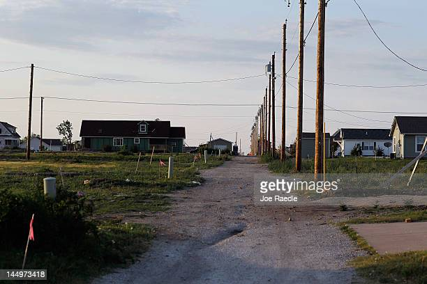 As the one year anniversary of the massive tornado that hit the town approaches an area that had been covered in debris and flattened homes is seen;...
